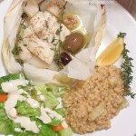 Baked Seafood in Parchment with Fennel and Sweet Onion Pearled Couscous
