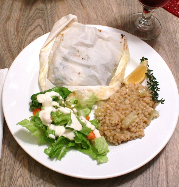 Baked seafood in parchment with pearled couscous