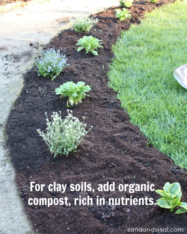 Adding curb appeal new flower beds sand and sisal for Organic compost soil