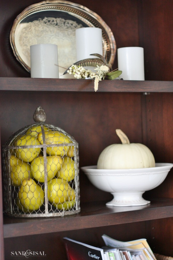 Bookcases decorated for fall - white pumpkins and pretty pears