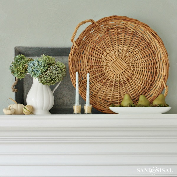 Early Fall Mantel - blue and green themed mantel. Group together green pears , white pumpkins and pretty dried hydrangeas.