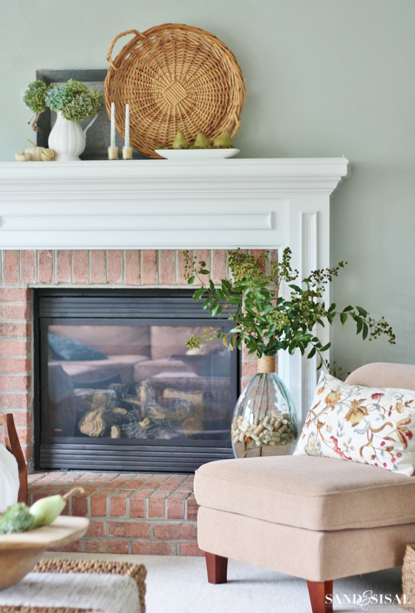 Early Fall Mantel using natural elements like white pumpkins, dried hydrangeas, pears and crepe myrtle branches. One of my favorite mantels of all time!