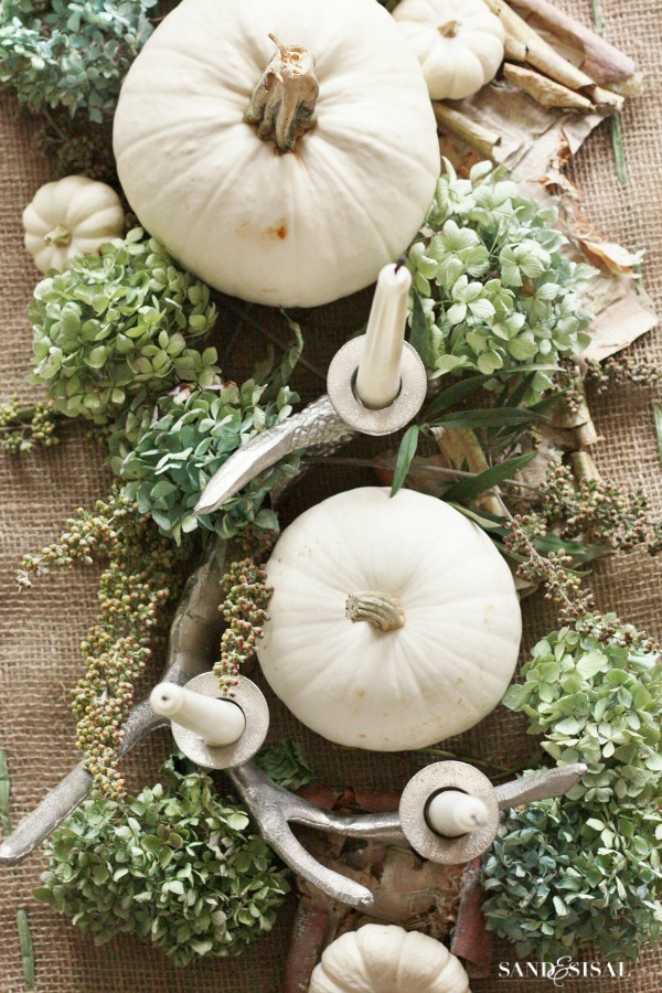 white pumpkin centerpiece sand and sisal