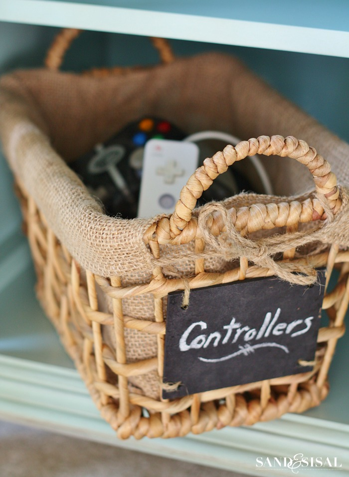 Entertainment Center Organization - Use a chalkboard labled basket to store game controllers