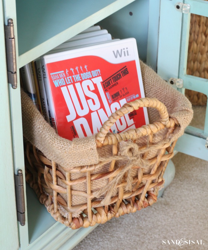 Entertainment Center Organization - Use pretty baskets to hold video games