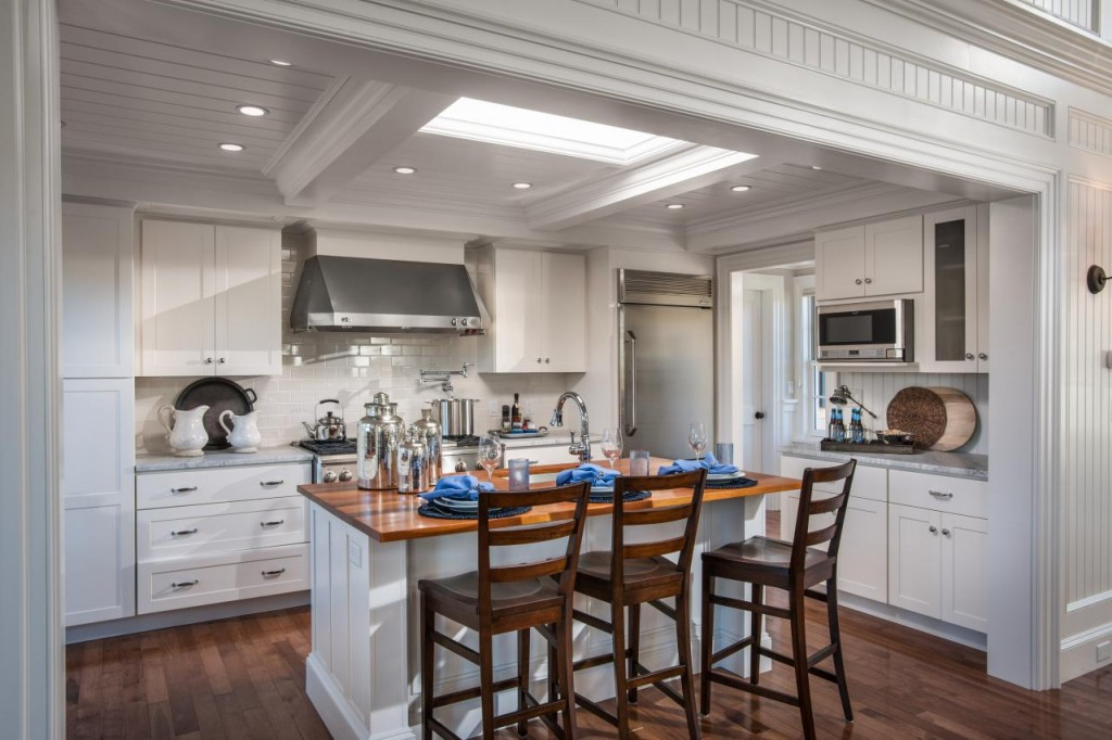 The great room extends though the dining area and open kitchen. The