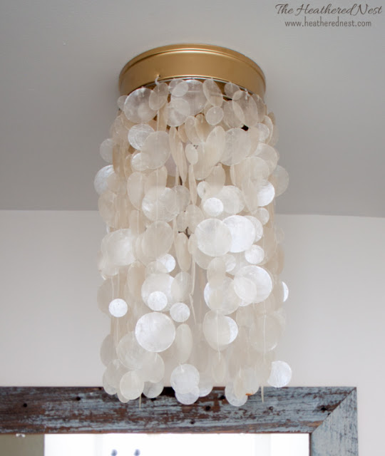 15 chic coastal crafts for the home sand and sisal for Shell ceiling light fixtures