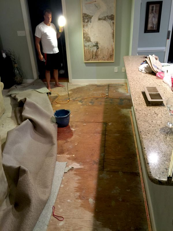 Wet subfloor from kitchen flood
