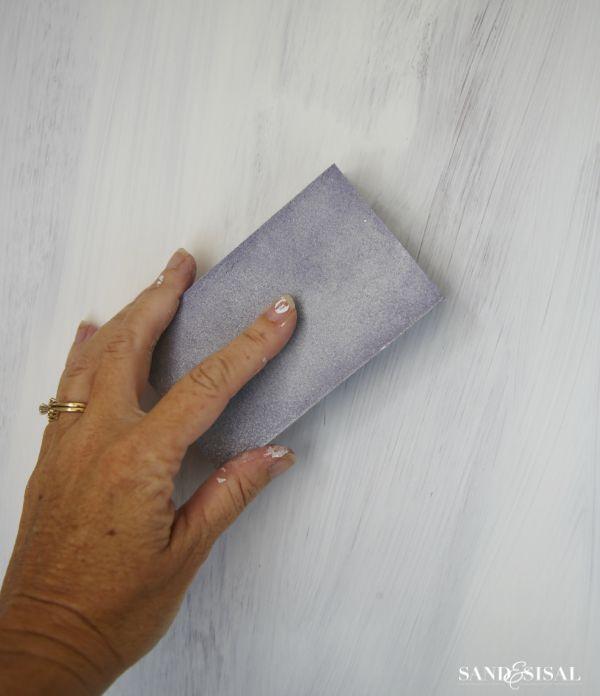 Use a sanding sponge between coats of chalk paint