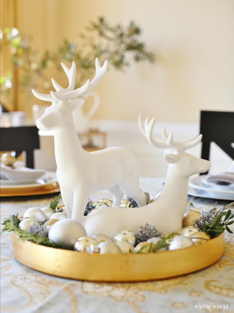 Christmas Reindeer Centerpiece - Super simple! Fill a tray with greens, ornaments and 2 reindeer statues. You can make it in less than 5 minutes!