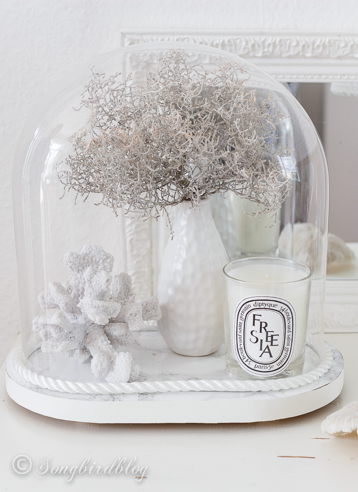 beach-decor-glass-cloche: Capture a bit of summer under a cloche or glass bell jar. Explore these beautifully chic coastal cloche decor ideas for your home.