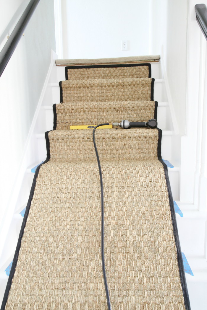 Installing a Seagrass Stair Runner - White Painted Staircase Makeover with Seagrass Stair Runner Tutorial