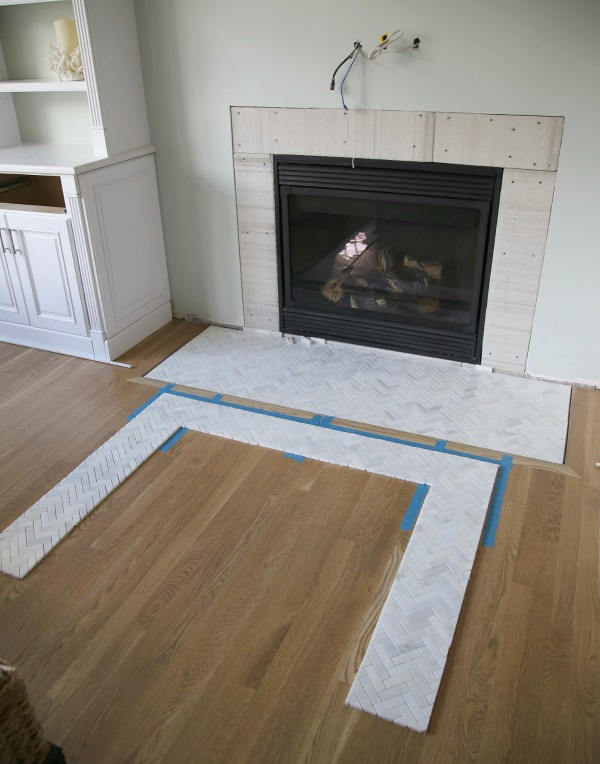 How to install a marble herringbone fireplace surround and for Wood floor up to fireplace