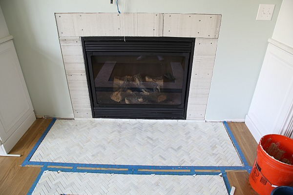 Upgrade your fireplace in a weekend! Get a step by step tutorial on how to install a marble herringbone fireplace surround and hearth.