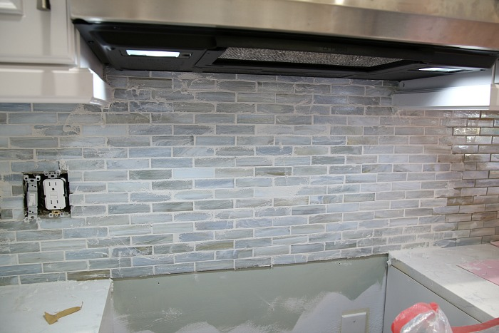 Applying grout to a backsplash