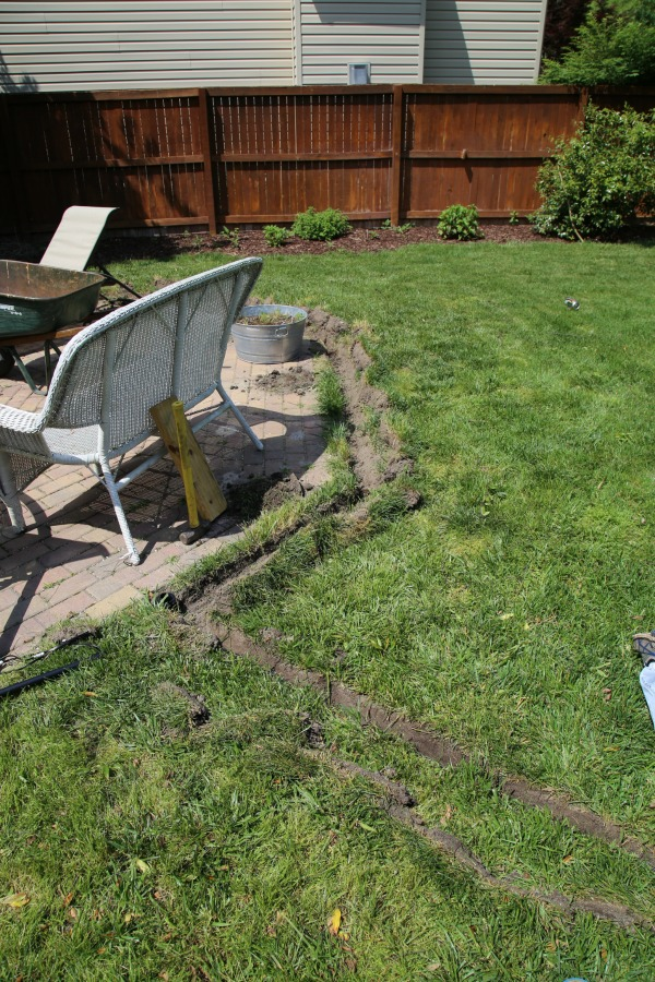 digging a trench for outdoor lighting
