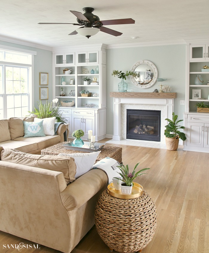 Coastal family room and fireplace makeover sand and sisal Family pictures on living room wall