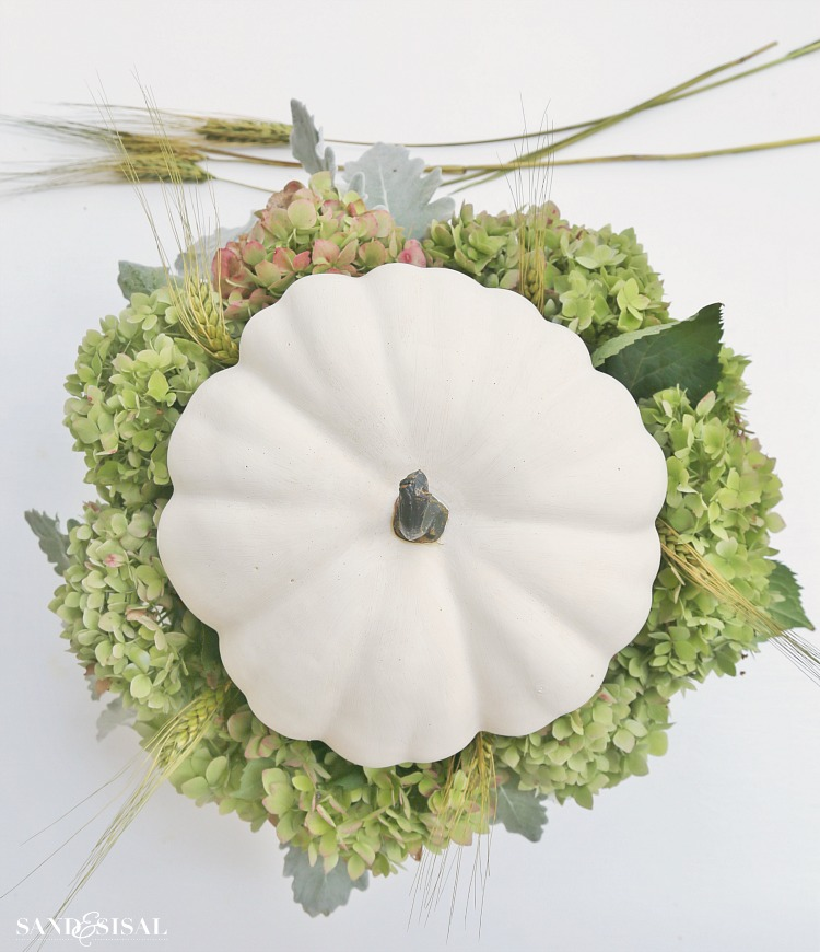step-4-insert-wheat-straw-and-pumpkin. White Pumpkin and Hydrangea Fall Centerpiece