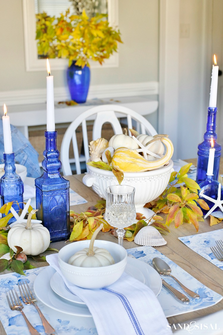 blue-and-yellow-fall-tablescape. Casual Coastal Thanksgiving Tablescape - white pumpkins. White and Blue decor.