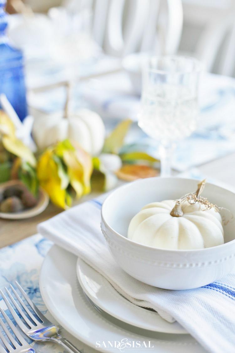 Casual Coastal Thanksgiving Tablescape - white pumpkins. White and Blue decor.