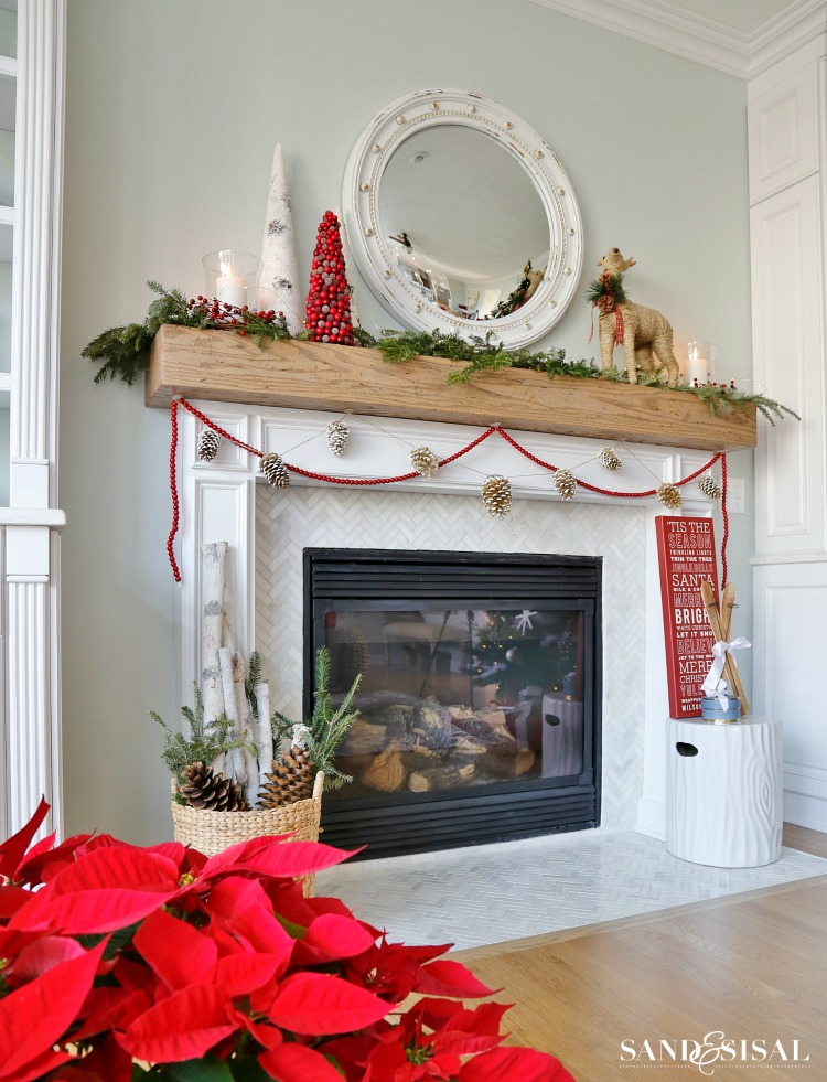cranberry-and-pinecone-garland-with-wood-beam-mantel