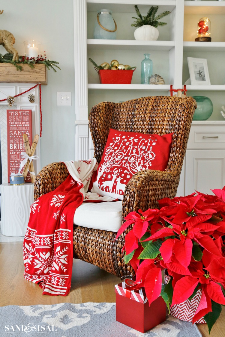 red-poinsettia-and-santas-chair