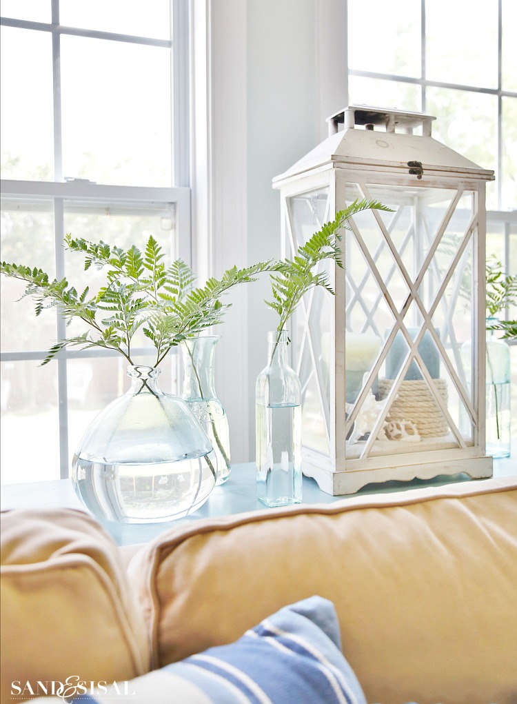ferns in vases - Escape to the sea with this summer blues coastal family room tour! Get easy coastal decorating ideas to transform your home into a chic coastal retreat. Complete with product source links!