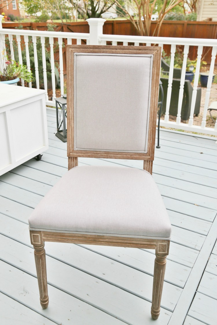 gray linen dining chairs with driftwood finish
