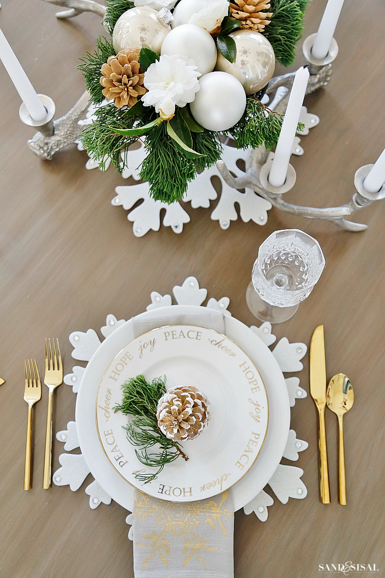 White Christmas Table Setting - Neutral Rustic Glam Christmas Dining Room. #rusticglam #rusticdecor #christmastable #neutralchristmas #rusticchic #coastalliving #diningroom