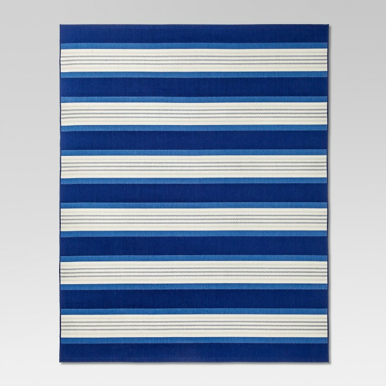 d8d87d68a67 First up are great coastal inspired rugs. This blue and white striped rug  is an all weather rug which would work fabulously on a patio